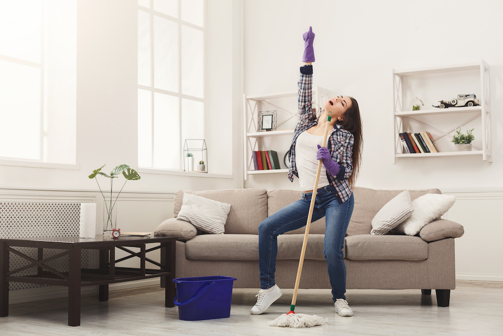 Happy woman cleaning