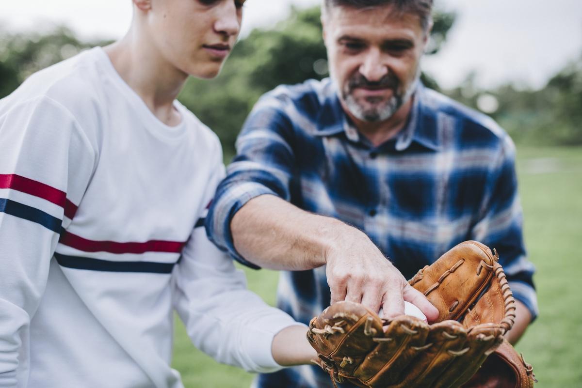 Father and son bonding over baseball