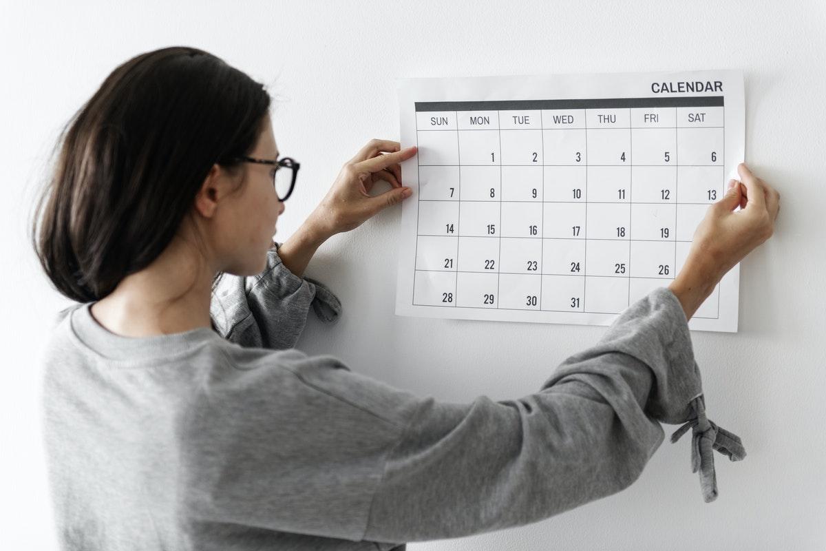 Woman checking the calendar
